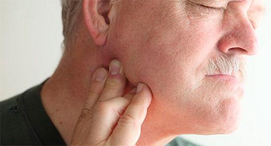 Почему болят челюстные суставы